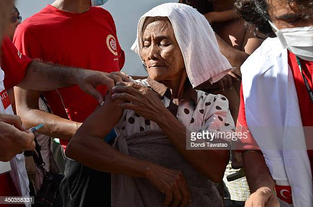 An old woman is given anti Hepatitis A shots during a medical mission on November 18 2013 in Tacloban Leyte Philippines Typhoon Haiyan which ripped...