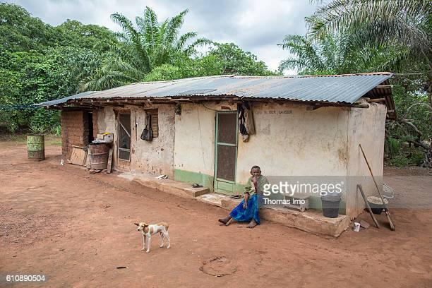 An old woman is sitting in front of a house on a cashew farm in Congo on September 06 2016 in Congo Ghana