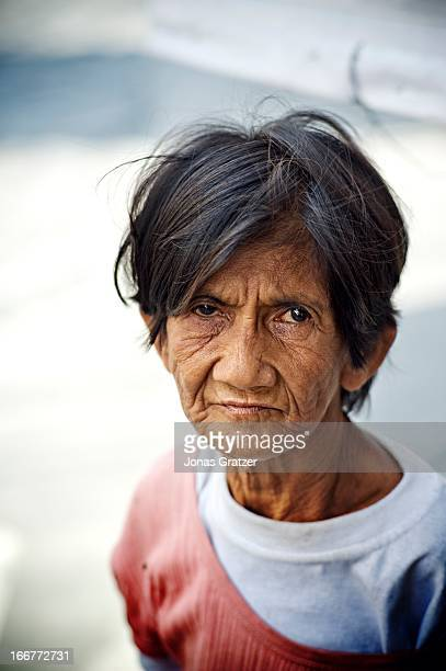 An old woman living on the streets of Manila