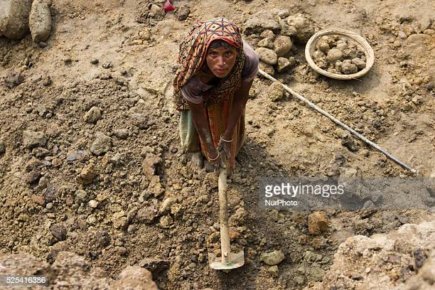 An old woman poses for the camera while working at the stone extraction site in Jaflong Sylhet Bangladesh on February 28 2015 Sylhet is a very...