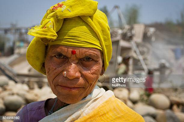 An old woman poses for the camera while working in a Stone Crashing Plant in Sylhet Bangladesh A huge percentage of stone is being supplied to all...