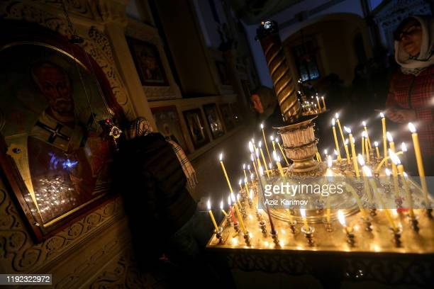 An old woman prays during an Orthodox Christmas service in a Holy Myrrhbearers Cathedral on January 6 2020 in Baku Azerbaijan Much of the former...