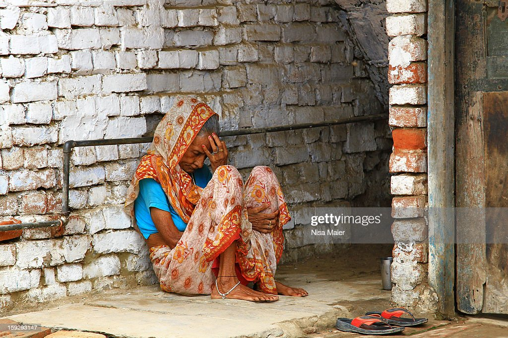 CONTENT] An old woman resting somewhere along the alleys in Varanasi. This is not an uncommon sight: many people arrive in Varanasi for their final days and have no place to go until this happens. There are shelters for these people, but some of them simply live it out in the streets.