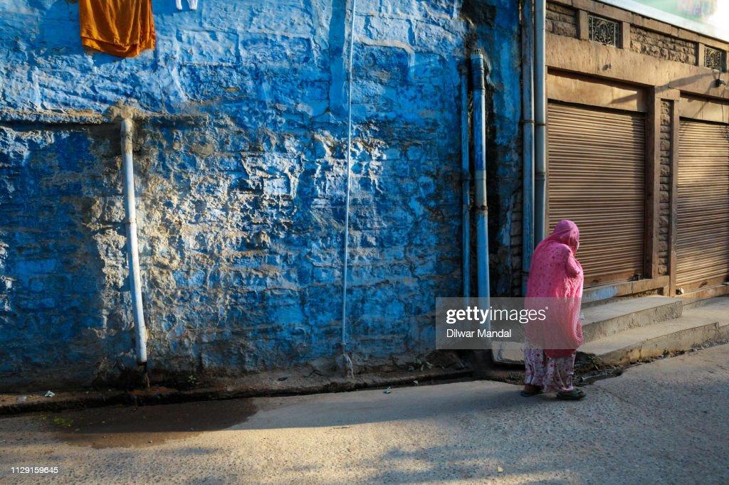 An old woman walking : Stock Photo