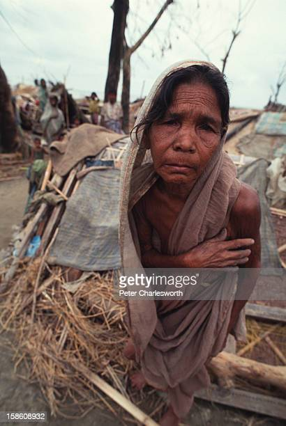 An old woman walks in front of a hastilyerected shelter built after one of the biggest cyclones to hit Bangladesh in recent decades had totally...