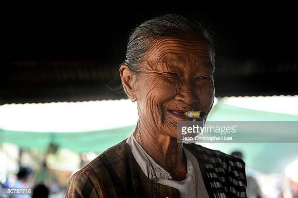 An old woman with a cheroot cigar in Inthein on Inle lake. Cheroots are traditional cigars in Myanmar. Tobacco is mixed with leaves, herbs and roots.