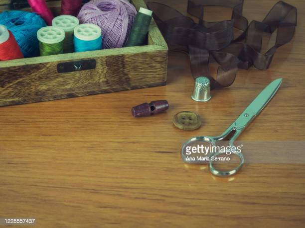 an old wooden box with vintage style sewing tools - ribbon sewing item stock pictures, royalty-free photos & images