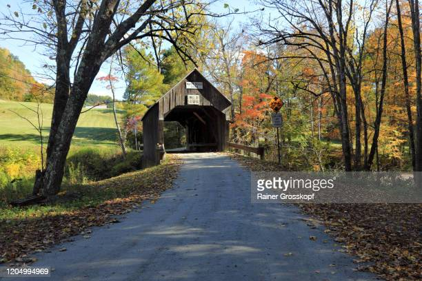 an old wooden covered bridge in a rural scenery - rainer grosskopf stock-fotos und bilder