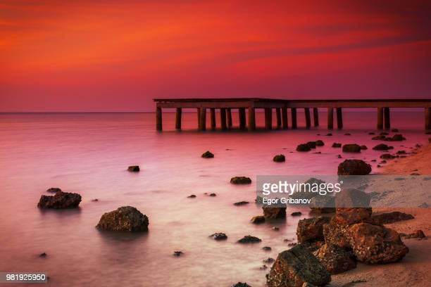 an old wooden pier - surat thani province stock pictures, royalty-free photos & images