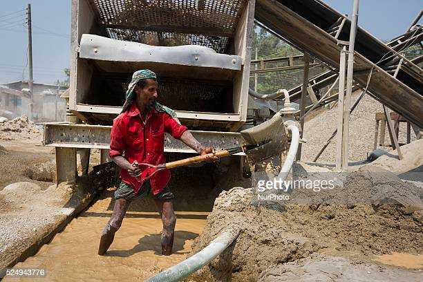 An old worker is collecting sands from the debris in a Stone Crashing Plant in Sylhet Bangladesh A huge percentage of stone is being supplied to all...