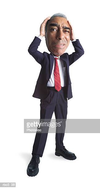 an older african american male wearing glasses and a suit stands with his heads on his head looking very stressed out