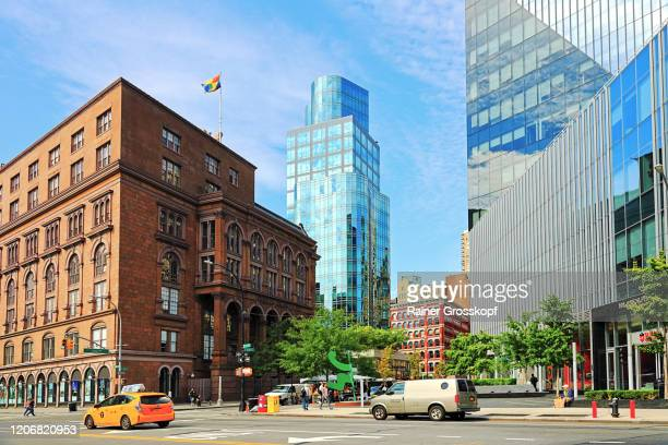 an older brick buiding and a modern tower with a glass facade at astor place - rainer grosskopf stock pictures, royalty-free photos & images