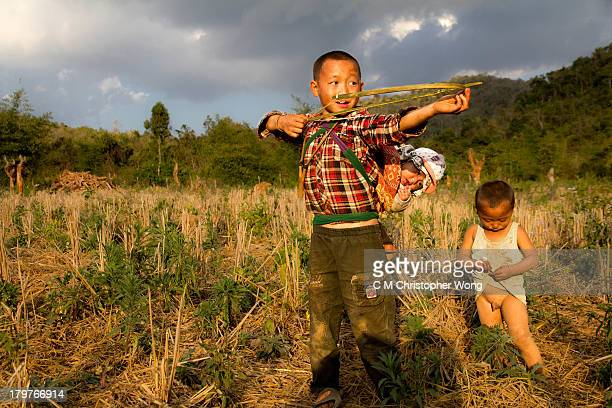 CONTENT] An older brother was babysitting his younger brothers while playing improvised bow and arrow on a dry field in Ban Tajok a village close to...