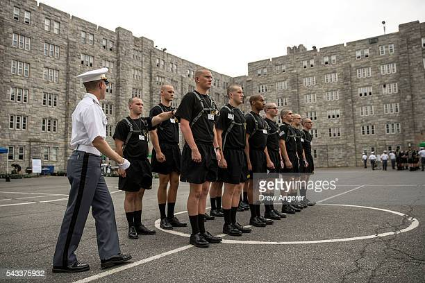 An older cadet surveys the form of new cadets during Reception Day at the United States Military Academy at West Point June 27 2016 in West Point New...