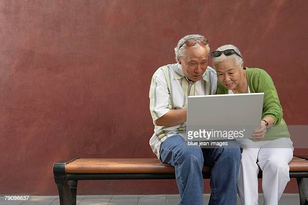 An older couple uses their laptop to stay connected.