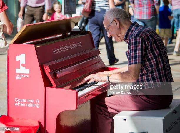 An older gentleman serenading the Liverpool public, on one of many pianos dotted around the Liverpool One shopping complex.