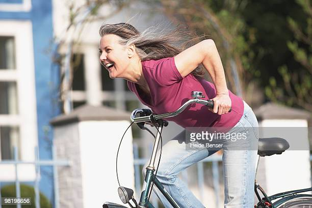 An older woman cycling
