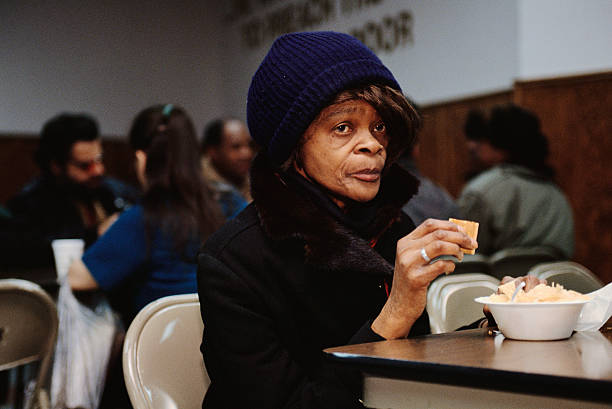 woman eating at soup kitchen in new york pictures getty images