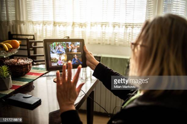 an older woman talks to her family through a video call - time stock pictures, royalty-free photos & images