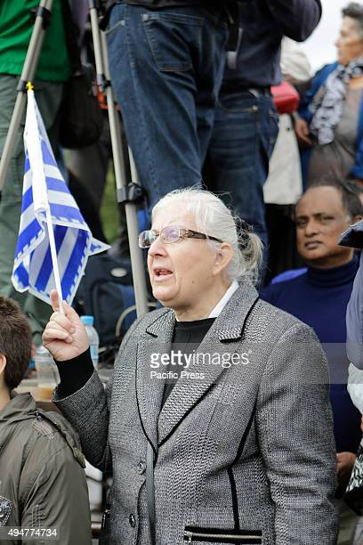 SQUARE ATHENS ATTICA GREECE An older woman watches the 'Oxi Day' parade in Athens waving a Greek flag School students marched in Athens in the 'Oxi...