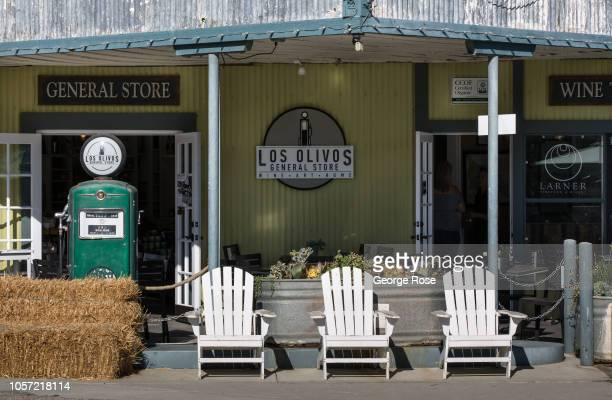 An old-fashioned gasoline pump and a grouping of Adirondack chairs are viewed outside the General Store on September 29 in Los Olivos, California....