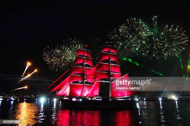 An oldfashioned tall ship sails on the Neva River in St Petersburg early on June 21 during the Scarlet Sails with laser show and fireworks to honour...