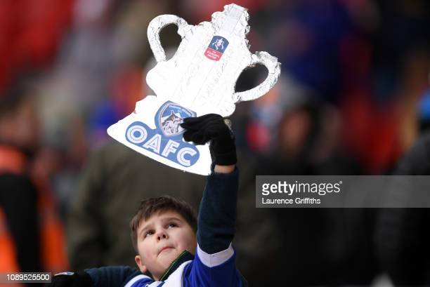 An Oldham Athletic fan shows their support prior to the FA Cup Fourth Round match between Doncaster Rovers and Oldham Athletic at Keepmoat Stadium on...
