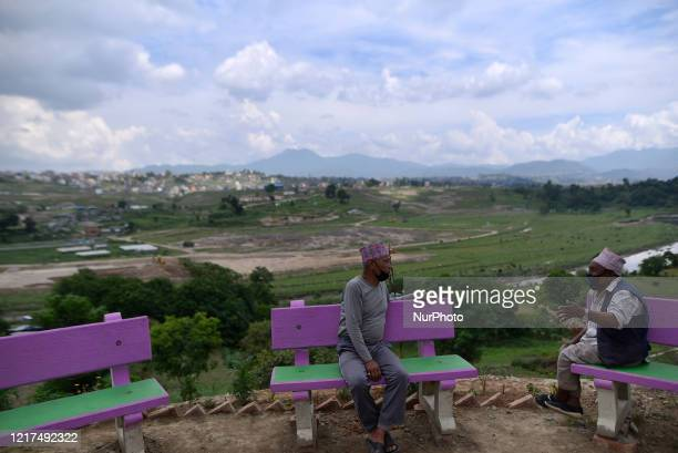 An oldman having lighter moment during ongoing nationwide lockdown as concerns about the spread of CoronaVirus in Kathmandu, Nepal on Wednesday, June...