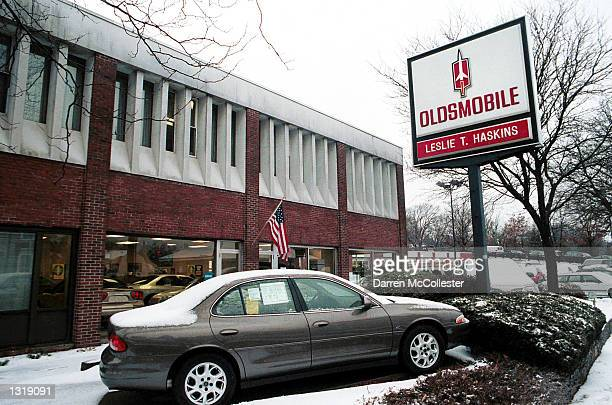An Oldsmobile is parked at an Oldsmobile dealership December 14 2000 in Wellesley MA General Motors Corp announced that over the next several years...