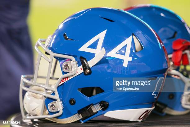An Ole Miss Bears helmet rests on the sideline during a football game between the LSU Tigers and Ole Miss Bears at Vaught Hemingway Stadium in Oxford...
