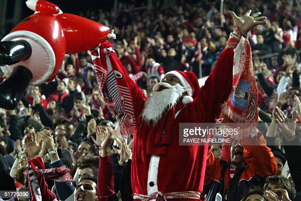 An Olympiakos' supporter dressed as Santa Claus cheers his team during the European Champions League football match Olympiakos vs Deportivo La Coruna...