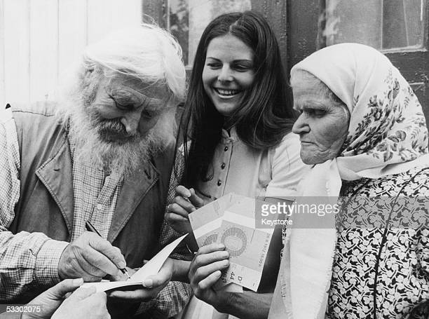 An Olympic hostess gives two free tickets to the opening ceremony of the Olympic Games in Munich to Russian monk Hermit Piotr Timofei and his 78...