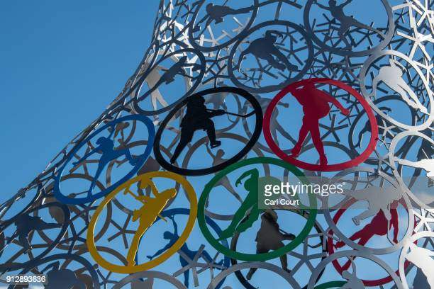 An Olympic logo depicting various winter sports is worked into a larger sculpture of an iceskate displayed at the Gangneung Coastal Cluster one of...