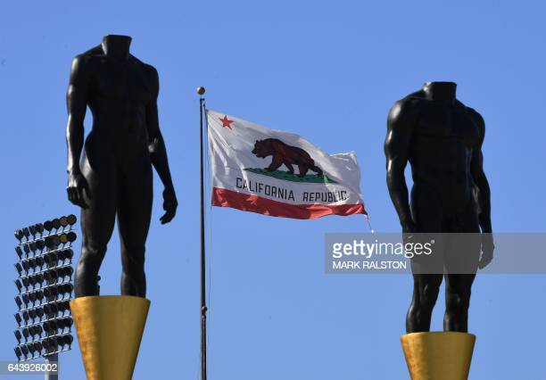 An Olympic themed monument stands beside the California state flag at the Los Angeles Memorial Coliseum after rival Budapest dropped its bid for the...