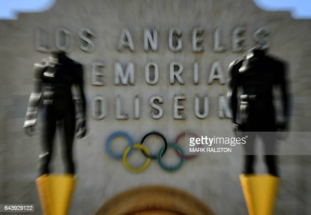 An Olympic themed monument stands beside the Los Angeles Memorial Coliseum after rival Budapest dropped its bid for the 2024 Olympics in Los Angeles...