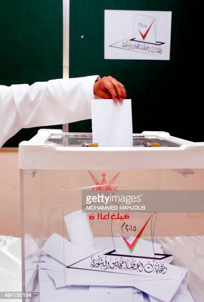 An Omani man casts his ballot at a polling station in Muscat for a consultative council on October 25 where the longtime ruling sultan holds all...