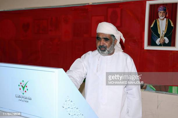 An Omani man casts his ballot at a polling station in the northeastern town of Izki during consultative council elections on October 27 2019 Omanis...