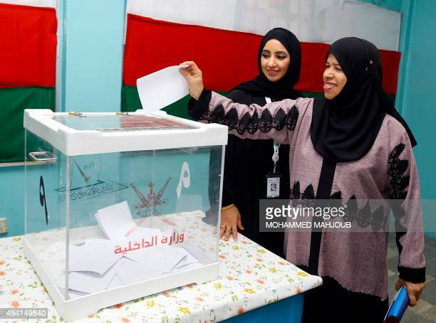 An Omani woman casts her ballot at a polling station in Muscat for a consultative council on October 25 where the longtime ruling sultan holds all...