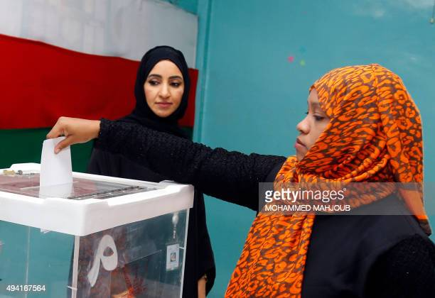 An Omani woman casts her ballot for a consultative council at a polling station in Muscat on October 25 where the longtime ruling sultan holds all...