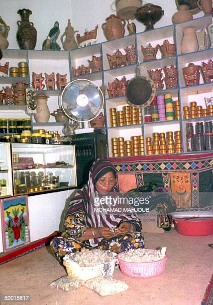 An Omani woman from the town of Salalah in Dhofar prepares Arabic gum in her incense and gum shop 20 August The region of Dhofar is renowned for...