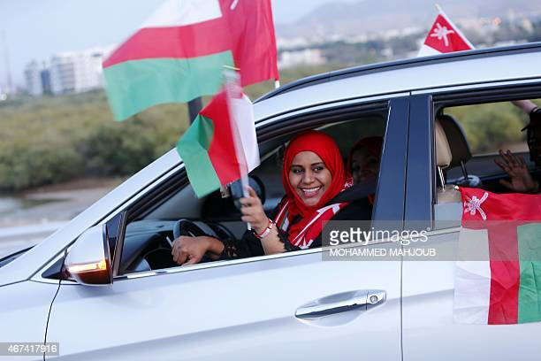 An Omani woman waves her national flag during celebrations for the return of leader Sultan Qaboos bin Said who flew home the previous day after he...