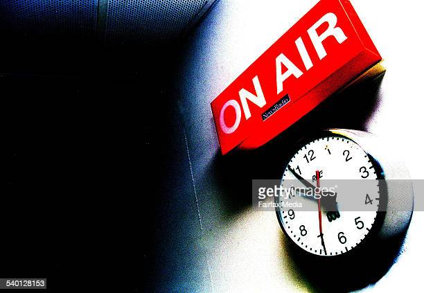 An 'on air' sign above a clock in a broadcasting studio 19 October 2002 AFR Picture by ROB HOMER