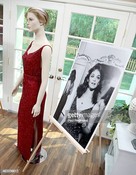 An on set still of Pamela Sue Martin next to a dress worn by the actress on the series photographed on the set of 'Dynasty' Reunion on 'Home Family'...