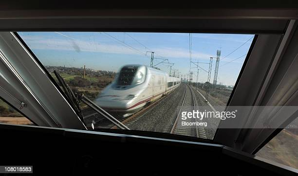 An oncoming Alta Velocidad Espanola highspeed train operated by RENFE is seen through the driver's cabin of an AVE passenger train on the Madrid to...