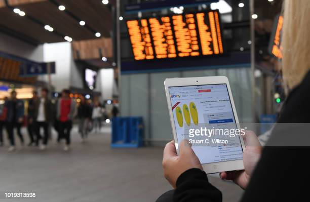 An online shopper uses the eBay mobile app at a train station on May 30 in London England eBay remains at the forefront of online retail The...