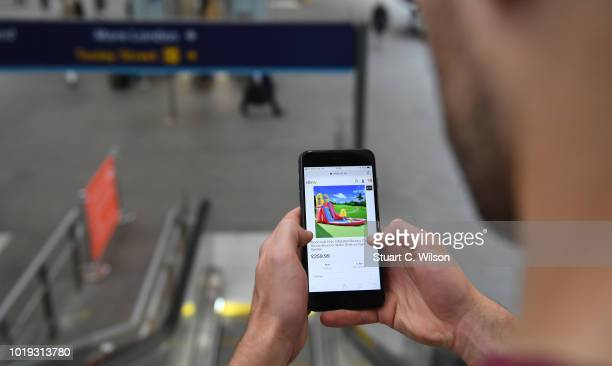 An online shopper uses the eBay mobile app at a train station on May 30 in London, England. EBay remains at the forefront of online retail. The...