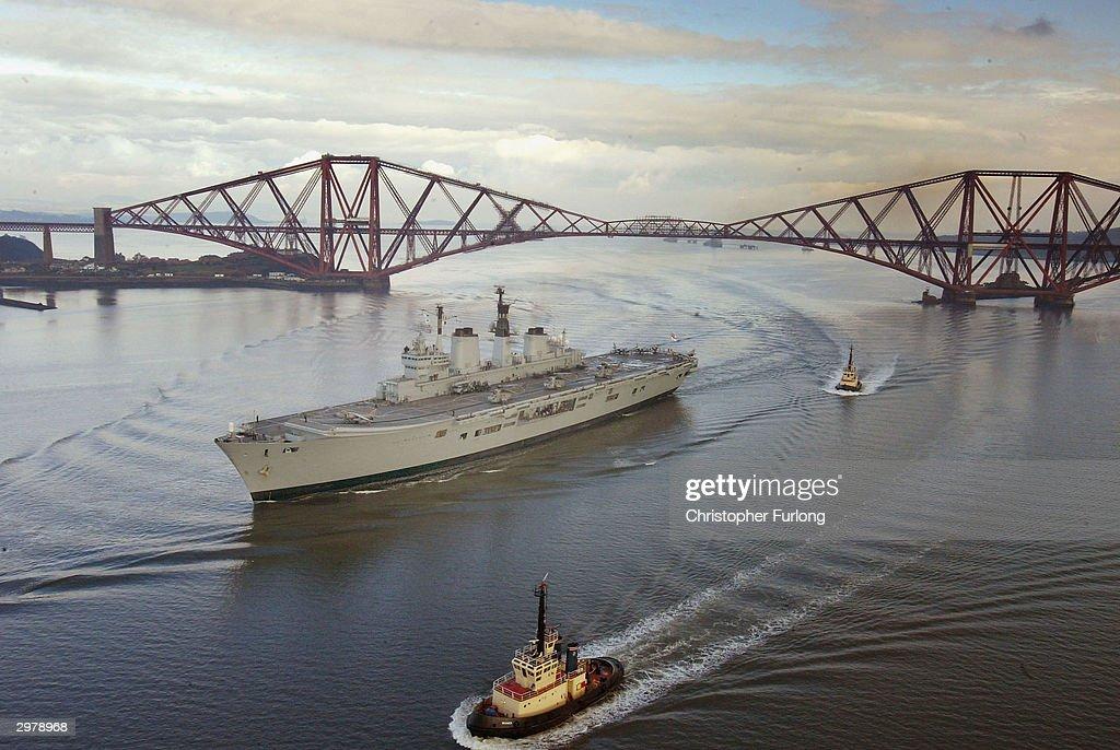 Aircraft Carrier HMS Ark Royal Sails Under The Forth Rail Bridge : News Photo