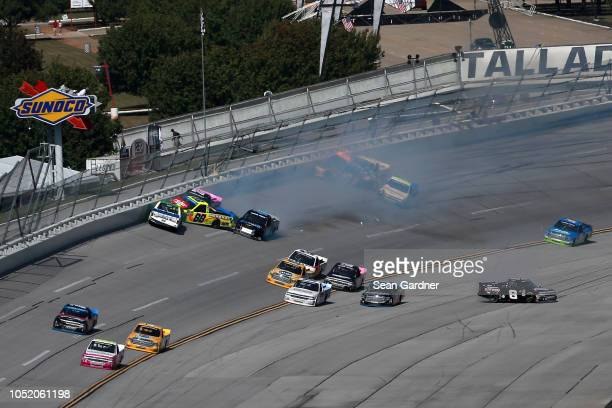 An ontrack incident takes place during the NASCAR Camping World Truck Series Fr8Auctions 250 at Talladega Superspeedway on October 13 2018 in...