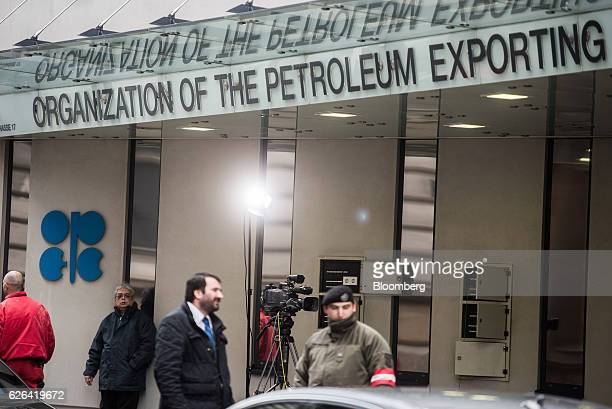 An OPEC logo sits on the wall as security and media stand outside of the OPEC Secretariat ahead of the 171st Organization of Petroleum Exporting...