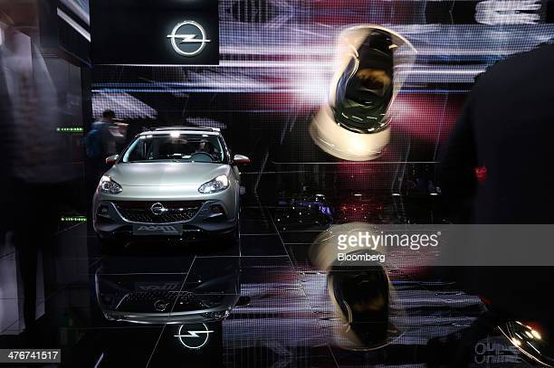 An Opel Adam automobile produced by General Motors Co sits on display at the company's stand on day two of the 84th Geneva International Motor Show...